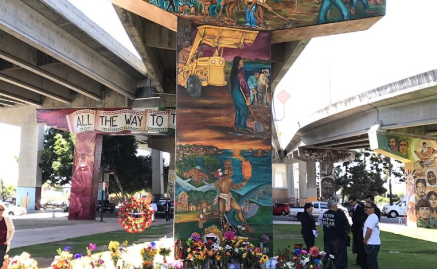 A growing memorial for the four people killed in Chicano Park after a car plunged off the Coronado Bridge, Oct. 18, 2016.