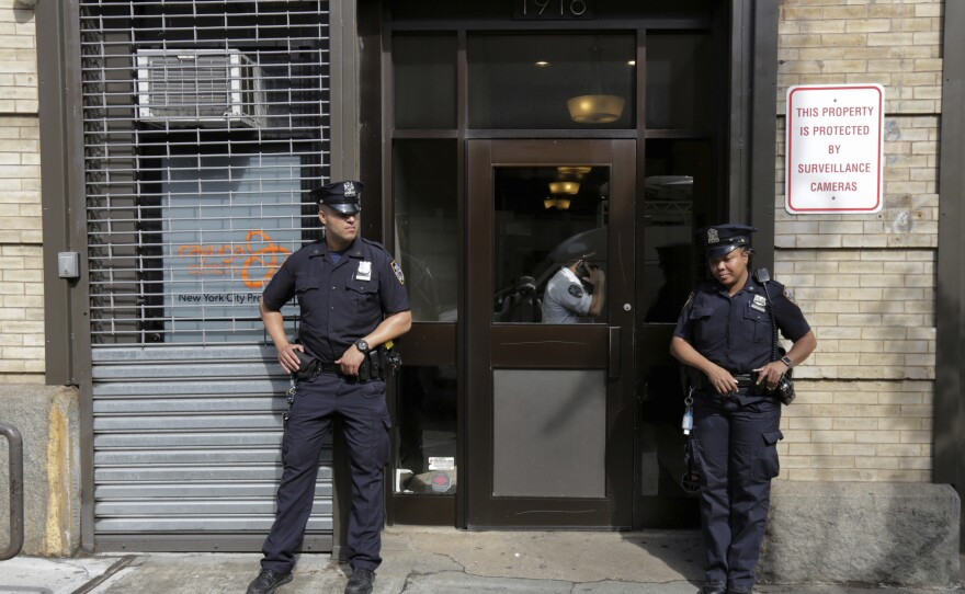 In this Thursday, June 21, 2018 file photo, police stand outside an office for the Cayuga Centers in the Brooklyn borough of New York. Three of the four incidents involving physical harm to separated immigrant children, outlined in legal filings, involved charges of Cayuga Centers, the largest foster care placement for migrant children.