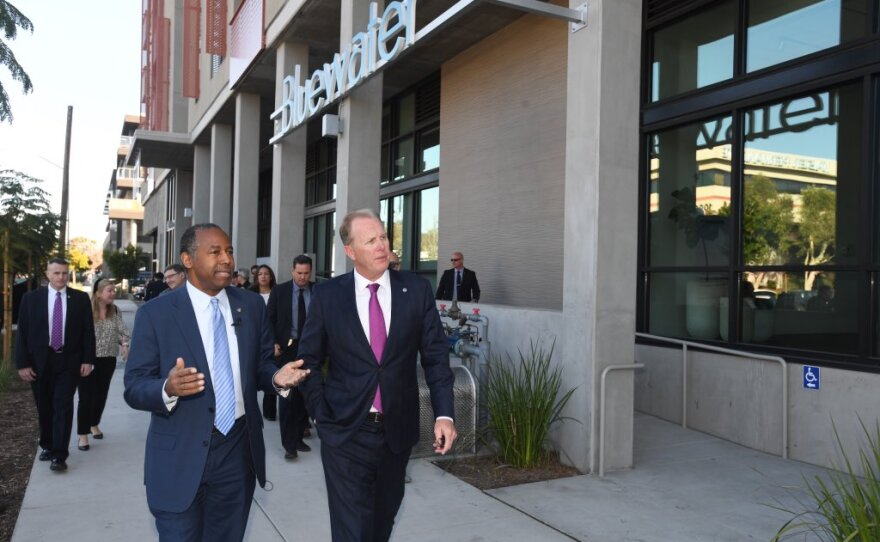 HUD Secretary Ben Carson (left) toured the Bluewater affordable housing complex in Grantville with Mayor Kevin Faulconer on Feb. 12, 2020.