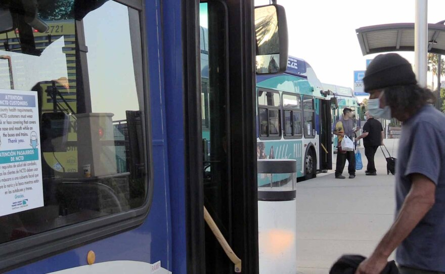A passenger getting on the North County Transit District Breeze bus at the Vista Transit Center, Sept. 10, 2021.