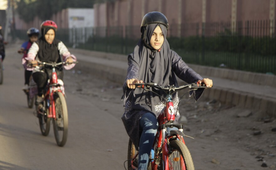 Zulekha Dawood leads the group of female cyclists through the impoverished Lyari neighborhood in Karachi, Pakistan's capital. They ride early in the morning to avoid the worst of the traffic.