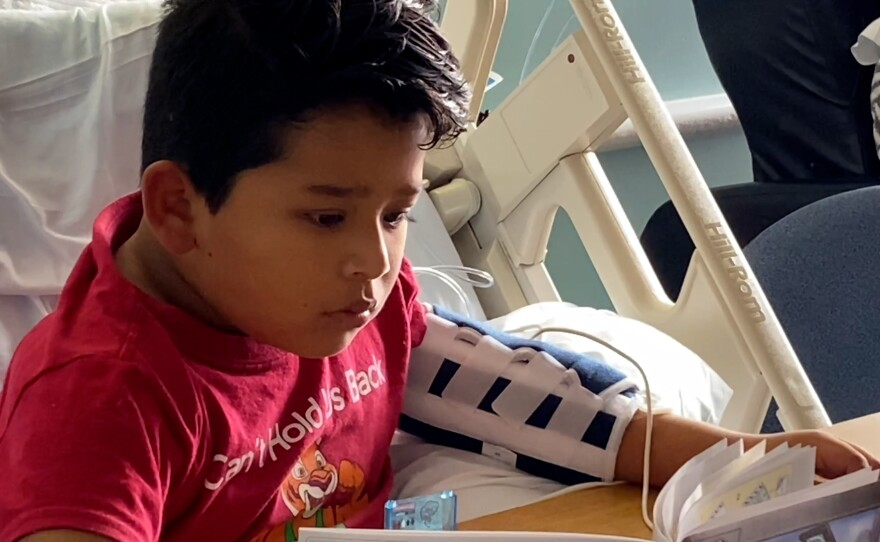 8-year-old Eduardo Cortes sits in a bed at Rady Children's Hospital in this undated photo.