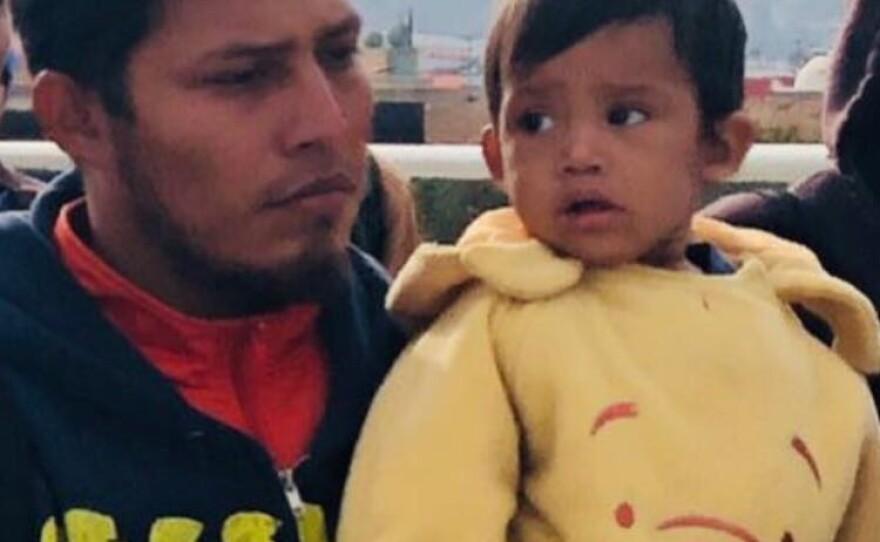 Jose Demar Fuentes carries his son Mateo near the San Ysidro Port of Entry, Nov. 12, 2017.