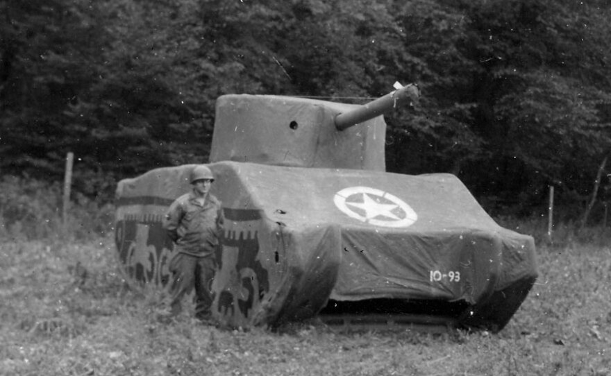 A Ghost Army soldier stands next to a rubber M4 Sherman tank, 93 pounds fully inflated. It took about 30 minutes to inflate a single tank, and the work was generally done at night so the Germans wouldn't see it.