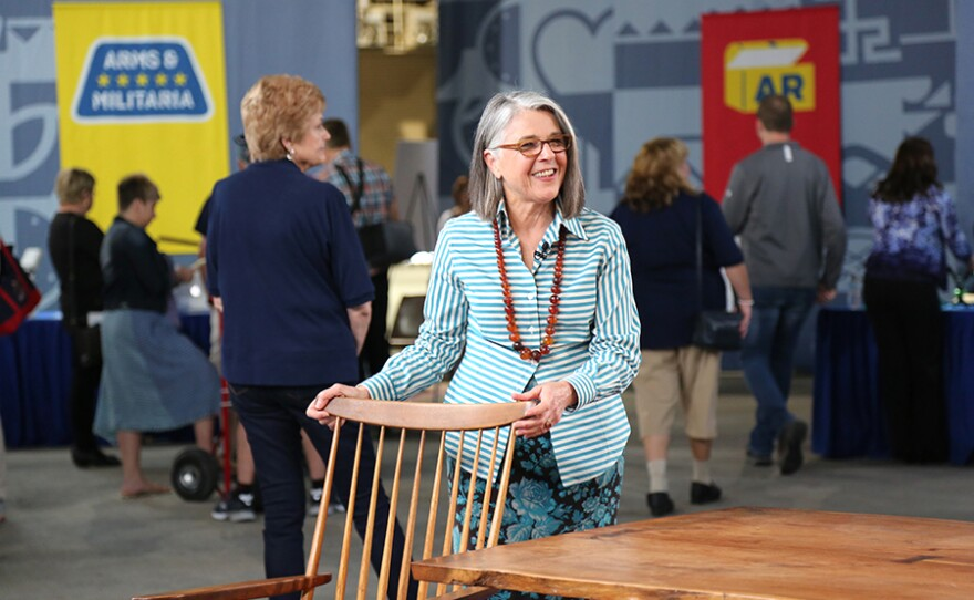 Karen Keane appraises a George and Mira Nakashima table and chairs