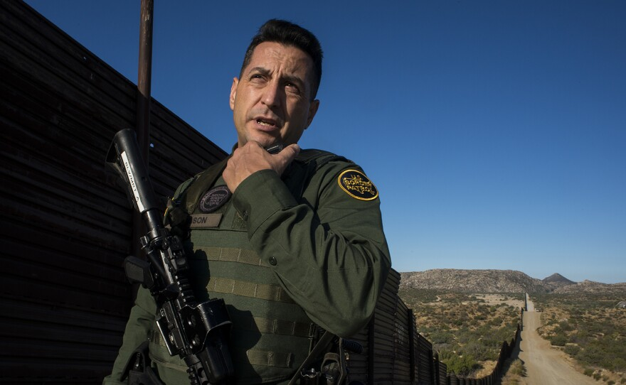 Border Patrol agent Joshua Wilson radios dispatchers to notify them of his location while touring the U.S.-Mexico border near Jacumba in eastern San Diego County on Sept. 5, 2017.