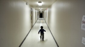 An asylum-seeking boy from Central America runs down a hallway after arriving at a shelter in San Diego, December 2018.