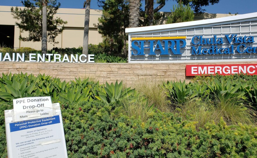 A sign in front of Sharp Chula Vista Medical Center on July 21, 2020, directing people where to go to drop off personal protective equipment donations for the hospital.