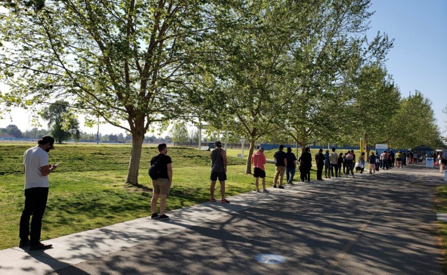 People line up for the Pfizer COVID-19 vaccine at CSU Bakersfield on April 7, 2021.