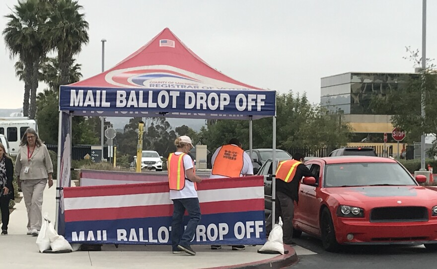 Voters drop off mail ballots at the San Diego County Registrar of Voters on Overland Avenue, June 5, 2018.