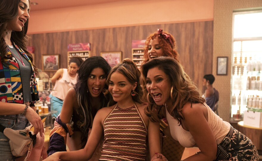 Singer and actor Leslie Grace stars as Nina Rosario (center), the beloved and brilliant neighborhood sweetheart in the film adaptation of the musical In the Heights.