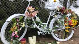 A memorial for Laura Shinn, who was struck and killed while biking to work, sits next to a fence on Pershing Drive in Balboa Park, July 26, 2021.