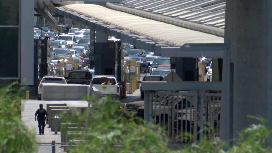 Cars wait in line to cross the San Ysidro border to San Diego, Aug. 3, 2018.