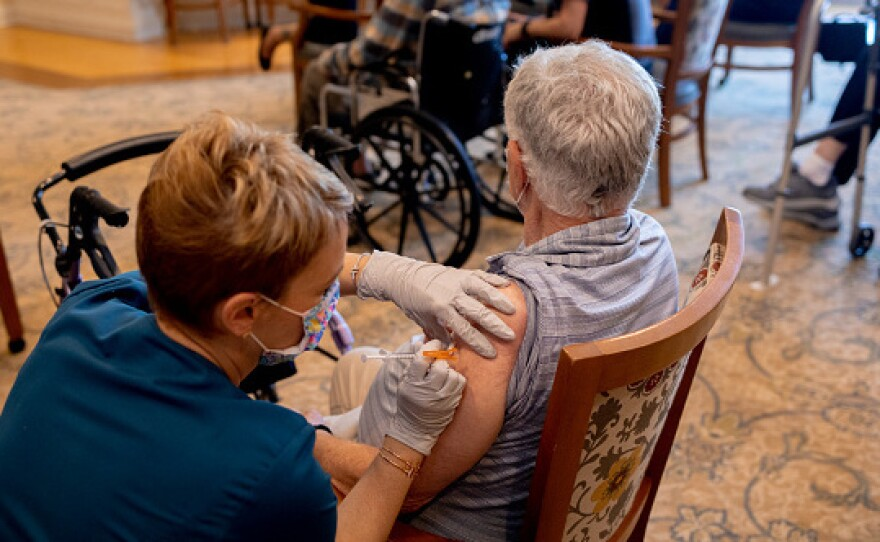 A health care worker administered a third dose of the Pfizer-BioNTech Covid-19 vaccine at a senior living facility in Worcester, Penn., in August.