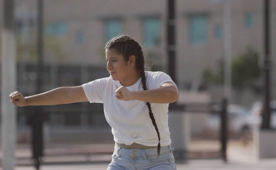 """A dancer from TranscenDANCE performs original choreography in a park for the """"Home Within A Home"""" film production, streaming Dec. 5 and 6, 2020."""