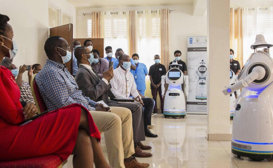 A robot introduces itself to patients in Kigali, Rwanda. The robots, used in Rwanda's treatment centers, can screen people for COVID-19 and deliver food and medication, among other tasks. The robots were donated by the United Nations Development Program and the Rwanda Ministry of ICT and Innovation.