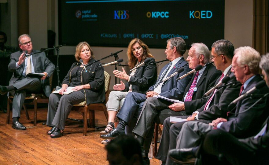 From left to right: Hosts Larry Mantle from KPCC and Maureen Cavanaugh from KPBS share the stage with Beth Webb, Marc Klaas, Mike Farrell, Tom Dominguez, Paul Pfingst and Justin Brooks at a death penalty town hall at the University of San Diego, Sept. 7, 2016.