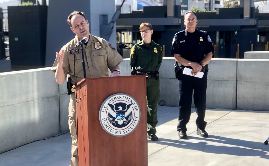 Tim Sutherland, director of Air and Marine Operations for California, speaking at the press conference about the increase in detentions at the U.S.-Mexico border in San Diego on Nov. 1, 2019, as Kathleen Scudder, acting chief Patrol Agent for the San Diego Sector, and Pete Flores, director of field operations for San Diego, look on.