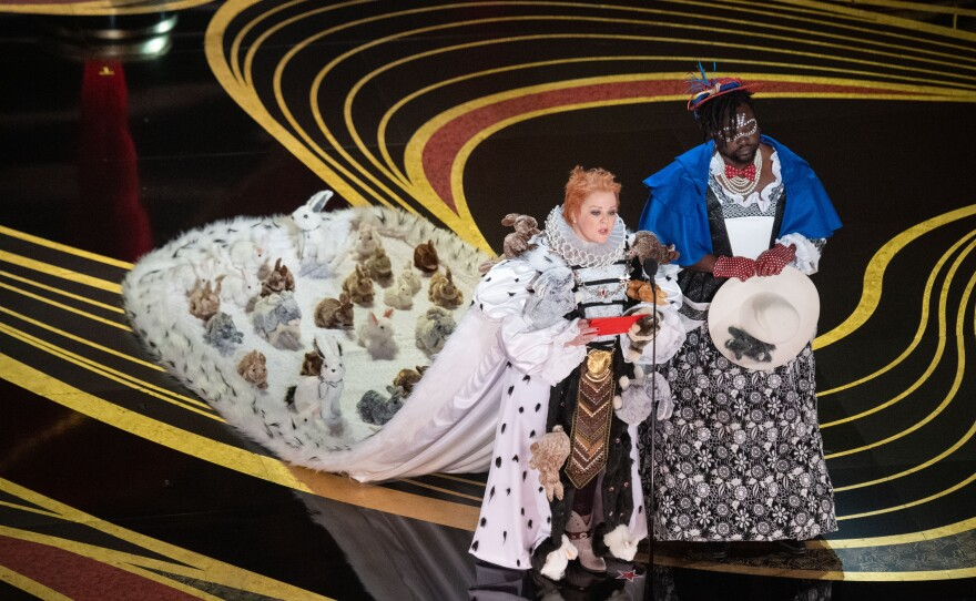 """Melissa McCarthy commanding all attention in her amazing get up to deliver the Best Costume award. The regal gown with all the rabbits was referencing """"The Favourite."""" Feb. 24, 2019"""