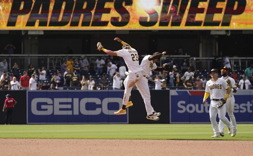 San Diego Padres shortstop Fernando Tatis Jr., left, celebrates with teammate center fielder Trent Grisham after the Padres defeated the Colorado Rockies 3-0 in a baseball game Wednesday, May 19, 2021, in San Diego.
