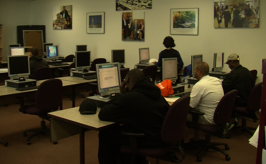People work on computers at a San Diego Workforce Partnership job center in San Diego, Feb. 5, 2016.