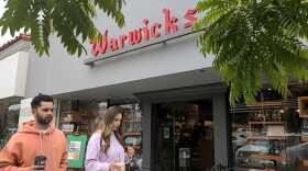 People walk past Warwick's bookstore in La Jolla, May 15, 2021.