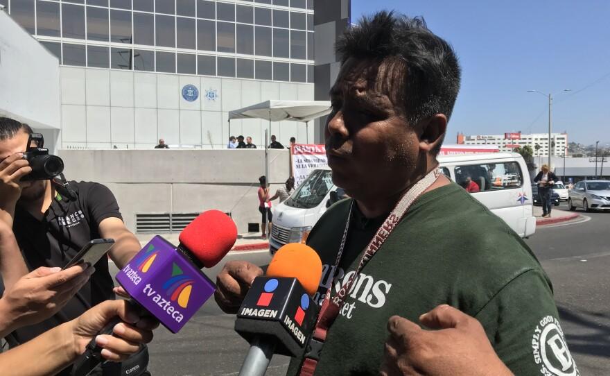 Irineo Mujica talks to reporters in Tijuana, Sept. 7, 2018.