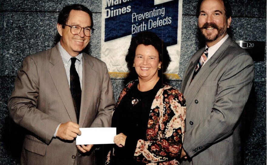 Cunningham, on behalf of the San Ysidro Health Center, accepts gift from the March of Dimes.