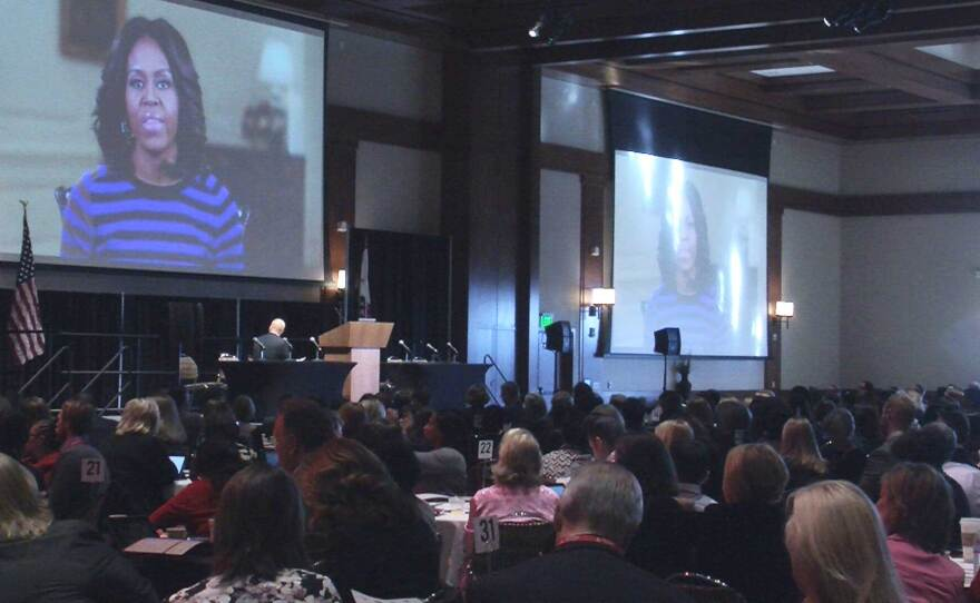 Hundreds of school counseling professionals from 32 states listen to a video message from first lady Michelle Obama about the value of school counseling programs.