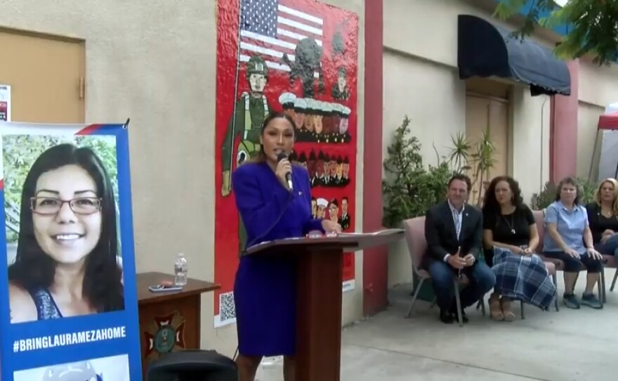 Air Force veteran Jennica Tamayo speaks about her experience with post-traumatic stress disorder at the unveiling of a mural honoring deported veterans in Barrio Logan on Aug. 23, 2021.