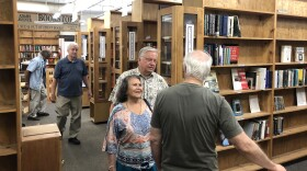 Customers make last-minute purchases at the Adams Avenue Book Store before it closes, July 13, 2018.