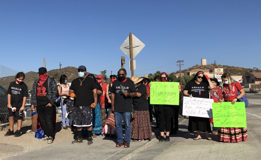 Members of the Kumeyaay Nation march to the Tecate port-of-entry to protest border wall construction on Indigenous Peoples' Day on Oct. 12, 2020.