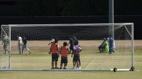 Children play soccer at an emergency shelter for migrant children Friday, July 2, 2021, in Pomona, Calif.