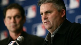 In this Dec. 7, 2005, file photo, San Diego Padres then-manager Bruce Bochy, left background, listens as then-general manager Kevin Towers, right, speaks during a news conference in Dallas.