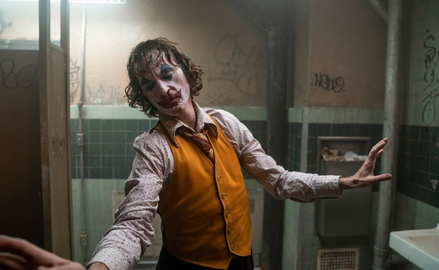 """This image released by Warner Bros. Pictures shows Joaquin Phoenix in a scene from """"Joker."""" On Monday, Jan. 13, the film was nominated for an Oscar for best picture."""