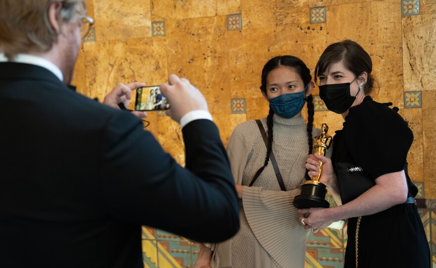 Chloé Zhao poses backstage with the Oscar® for Directing during the live ABC Telecast of The 93rd Oscars® at Union Station in Los Angeles, CA on Sunday, April 25, 2021.