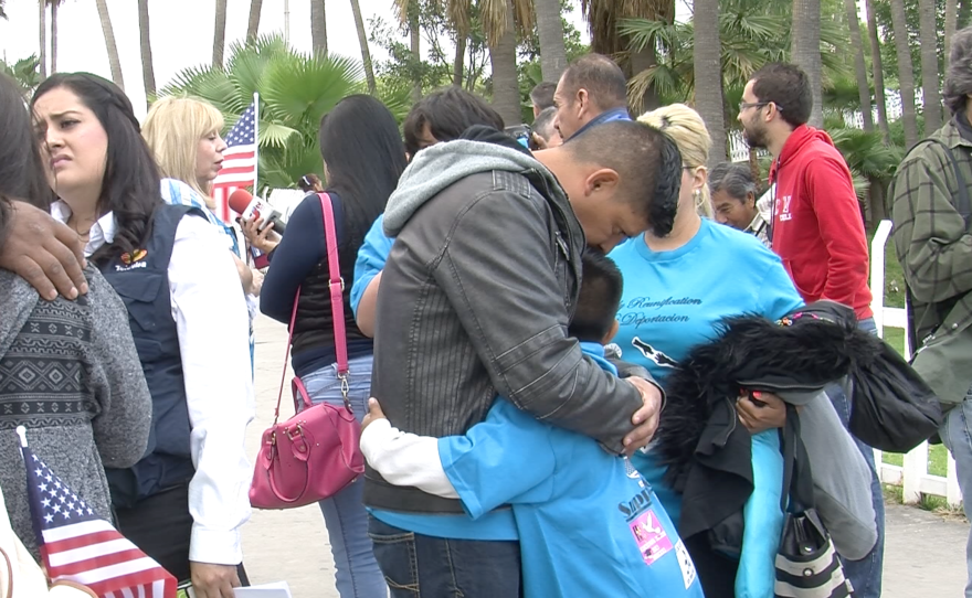 Victor Ledezma comforts his nine-year-old epileptic son in Tijuana, May 8, 2015.