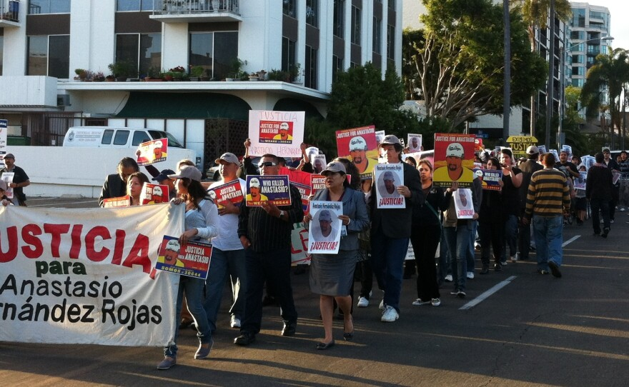 About 150 people marched from San Diego's Balboa Park to downtown as part of a national campaign asking the Justice Department to investigate the 2010 death of Anastasio Hernandez Rojas, May 3, 2012.