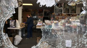 A hole in the window of a comic book store in La Mesa following a night of protests, May 31, 2020.