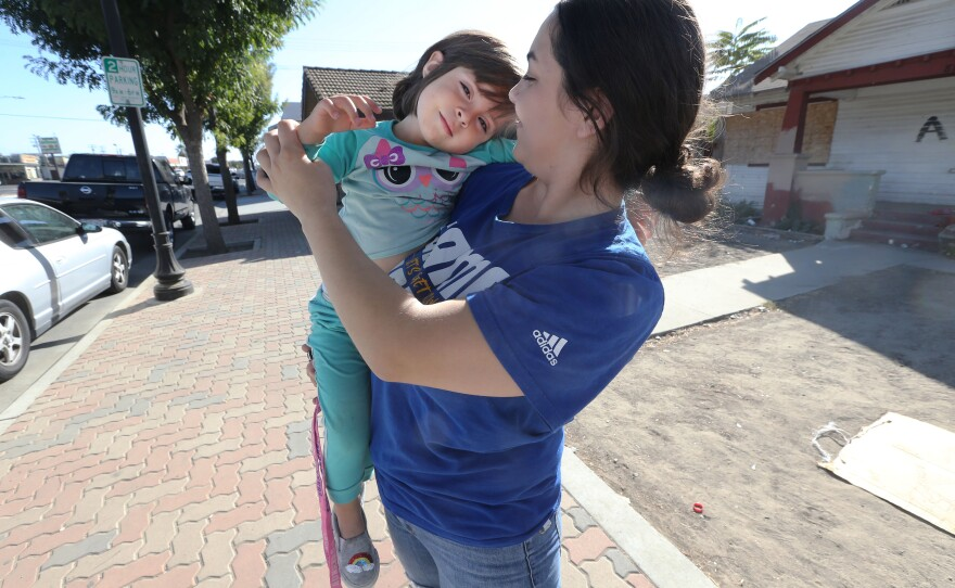 Diana Shalabi, 20, with her three-year-old, Amina, in Delano, California, in this photo taken Nov. 1, 2019.