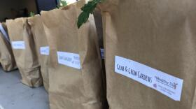 Bagged startup gardening kits, called Grab and Grow Gardens, await distribution at Kitchens for Good in Chollas View.