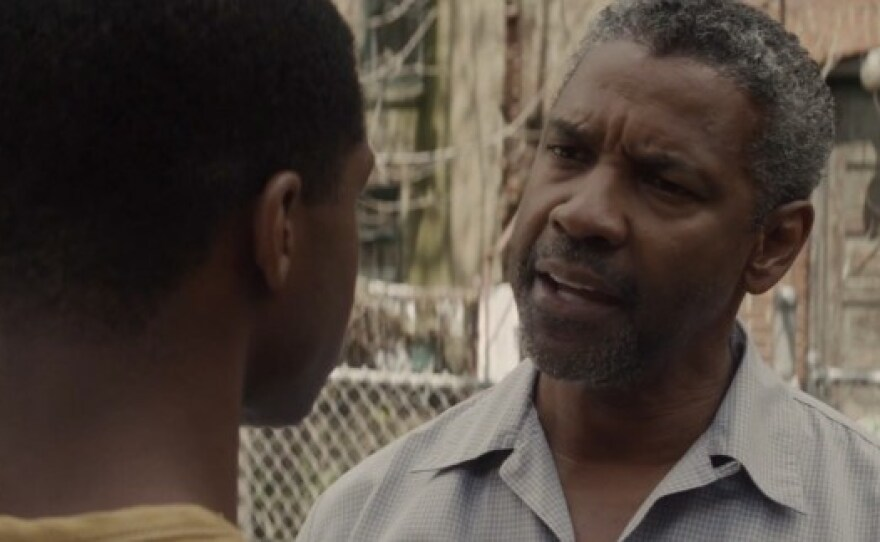 """Cory (Jovan Adepo) confronts his father Troy (Denzel Washington) in the film adaptation of August Wilson's play """"Fences."""""""