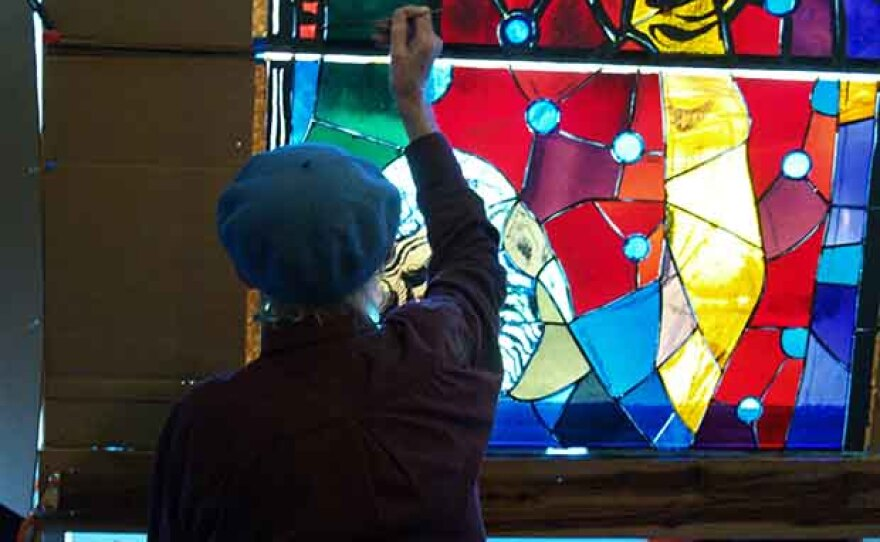 """Rowan LeCompte painting on glass. """"Let There Be Light"""" follows two grand masters of stained glass (Rowan LeCompte and Dieter Goldkuhle) as they work on their last window for the Washington National Cathedral."""