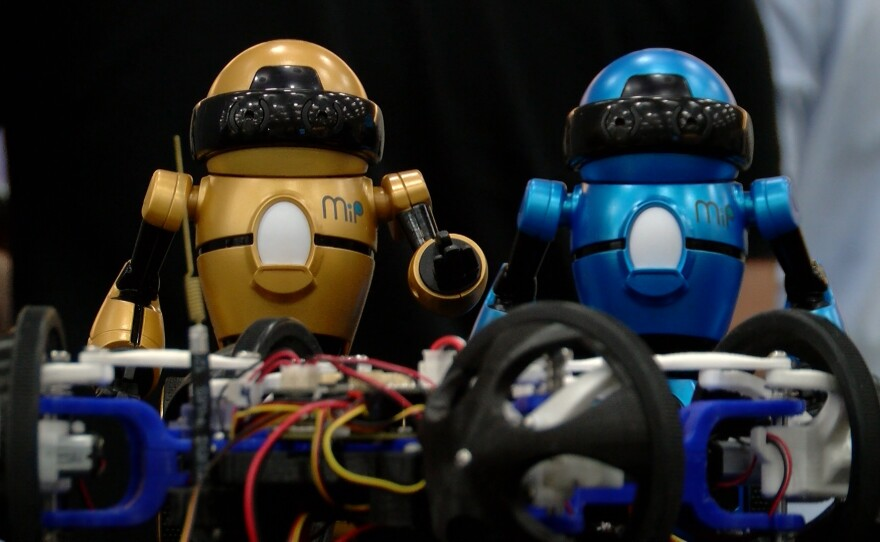 Two small robots are on display at the RoboUniverse Conference at the San Diego Convention Center, Dec. 16, 2015.