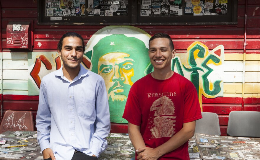 Davide Carpano and Rene Vera are volunteers who help run the CHE Cafe, which may close later this year.