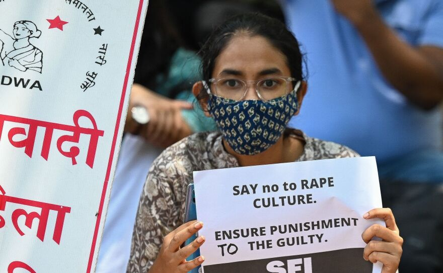 Activists of Student Federation of India and All India Democratic Women's Association hold placards during a protest against the alleged rape and murder of a nine-year-old girl, in New Delhi on August 4, 2021.