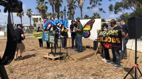 San Diego Green New Deal Alliance rallies support for president's budget plan because it contains major funding for climate friendly policies on Aug 19, 2021.