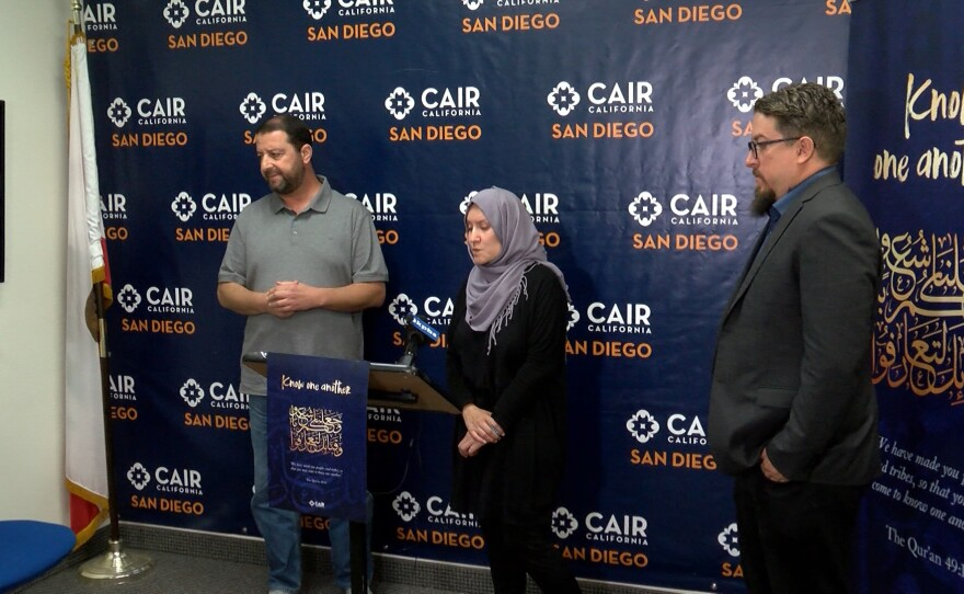 Imam Taha Hassane, Director of the Islamic Center of San Diego, Aleena Jun Nawabi, Administrative and Outreach Coordinator of CAIR California and Dustin Craun, Executive Director of CAIR of San Diego, stand at a podium at a press conference to address a hate crime investigation, Oct. 17, 2019.