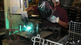 Alberto Martinez welds steel at a maquila owned by Metal Industries of Florida in Reynosa, Mexico in this undated photo.