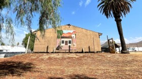 The wooden structure that protects the Trujillo Adobe is decorated with a mural of what the structure once looked like.